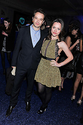 ZOE TAPPER and OLIVER DIMSDALE at the Warner Music Group Post Brit Awards Party in Association with Samsung held at The Savoy, London on 20th February 2013.