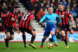 Jack Wilshere of Arsenal makes his way past a group of bournemouth players. - Mandatory by-line: Alex James/JMP - 14/01/2018 - FOOTBALL - Vitality Stadium - Bournemouth, England - Bournemouth v Arsenal - Premier League