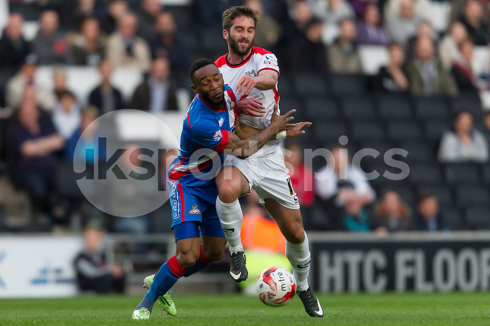 Will Grigg of MK Dons is blocked during the Sky Bet League 1 match between Milton Keynes Dons and Doncaster Rovers at stadium:mk, Milton Keynes, England on 21 April 2015. Photo by Gareth  Brown.