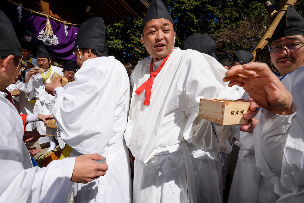Men in traditional Shinto clothing drink sake during Honen-sai, a fertility festival at Tagata Shrine in Komaki, Aichi Prefecture, Japan. The traditional Shinto festival celebrates fertility and a bountiful harvest. The principal offering during the festival is a large wooden phallus. Each year a craftsman carves a new phallus from a Japanese cypress tree. It measures almost 2.4 meters (13 feet) long and weights 280kg (620 pounds).