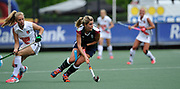 Surbiton's Georgie Twigg looks to set something up against Amsterdam during the bronze medal match at the EHCC 2017 at Den Bosch HC, The Netherlands, 5th June 2017