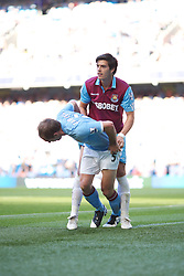 MANCHESTER, ENGLAND - Sunday, May 1, 2011: Manchester City's Pablo Zabaleta and West Ham United's James Tomkins during the Premiership match at the City of Manchester Stadium. (Photo by David Tickle/Propaganda)