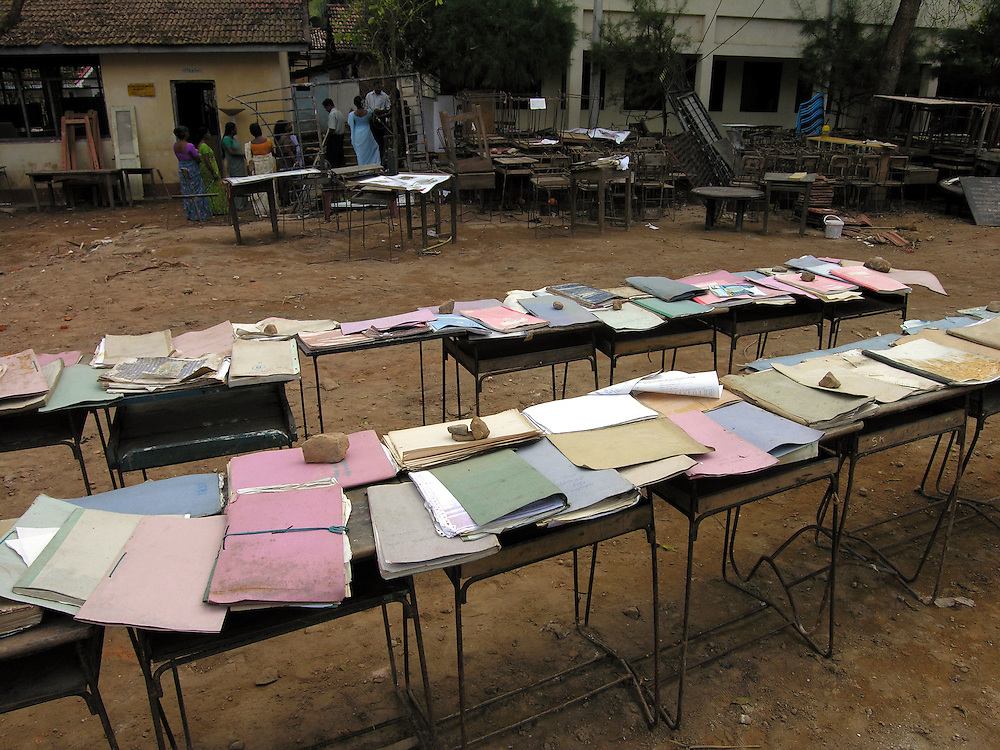 School documents drying in the sun at the Sujatha College. Many schools in areas affected by the Tsunami lost all their records and registration documents. Schools undamaged by the Tsunami re-opened around the country on January 10th after a one week delay. The government wants schools in the disaster zone to open by January 25th..Galle, Sri Lanka. 17/01/2005.Photo © J.B. Russell