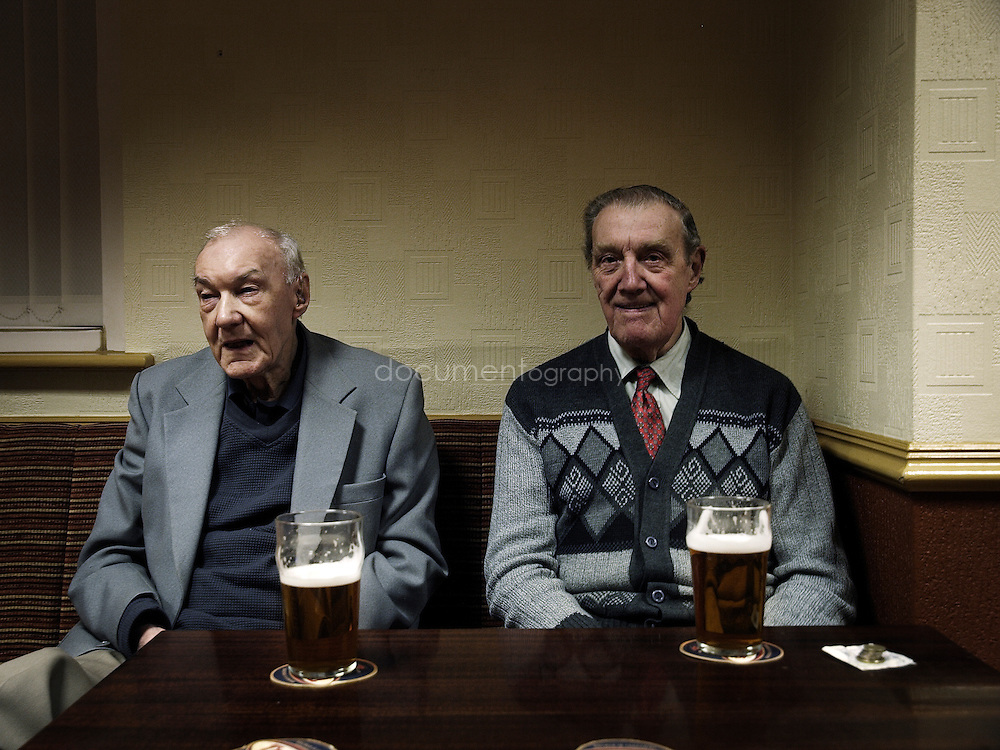 Former miners John Huges (right) and Alf Cooper (left) having a beer at the The Miners' Welfare Club in Denaby.