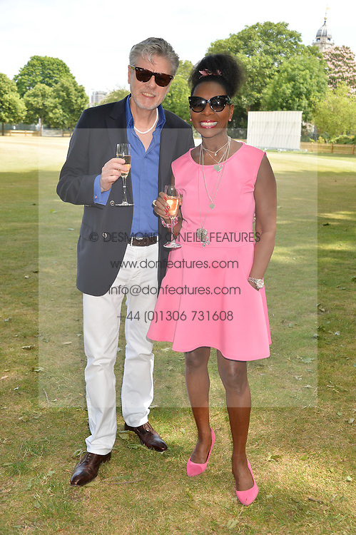 BARONESS BENJAMIN and her husband KEITH TAYLOR at the Flannels For Heroes cricket competition in association with Dockers held at Burton Court, Chelsea, London on 19th June 2015