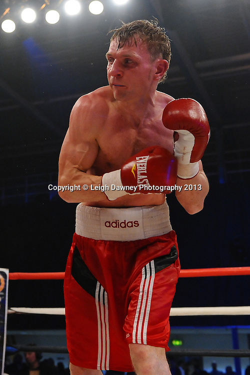 Lenny Daws defeats Arek Malek (pictured) in a Light Welterweight contest on 15th March 2014 at the Rivermead Leisure Centre, Reading, Berkshire. Promoted by Hennessy Sports. © Leigh Dawney Photography 2014.