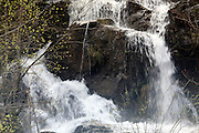 waterfall with water rushing down during spring season