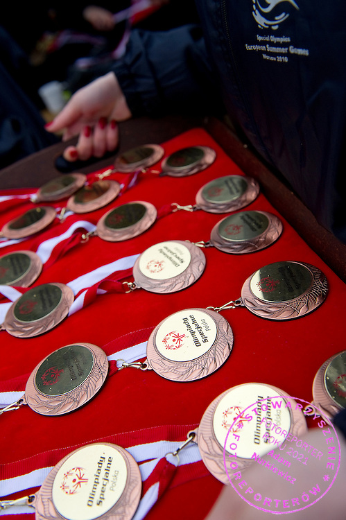 Medals of Polish Soccer Tournament Unified of Special Olympics in Mietne on April 28, 2013.The idea of Special Olympics is that, with appropriate motivation and guidance, each person with intellectual disabilities can train, enjoy and benefit from participation in individual and team competitions...Poland, Mietne, April 28, 2013..Picture also available in RAW (NEF) or TIFF format on special request...For editorial use only. Any commercial or promotional use requires permission...Mandatory credit: Photo by © Adam Nurkiewicz / Mediasport