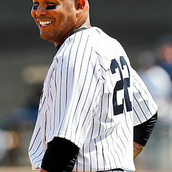 March 4, 2012; Tampa Bay, FL, USA; New York Yankees left fielder Andruw Jones (22) talk during spring training game against the Philadelphia Phillies at George M. Steinbrenner Field. Mandatory Credit: Derick E. Hingle-US PRESSWIRE