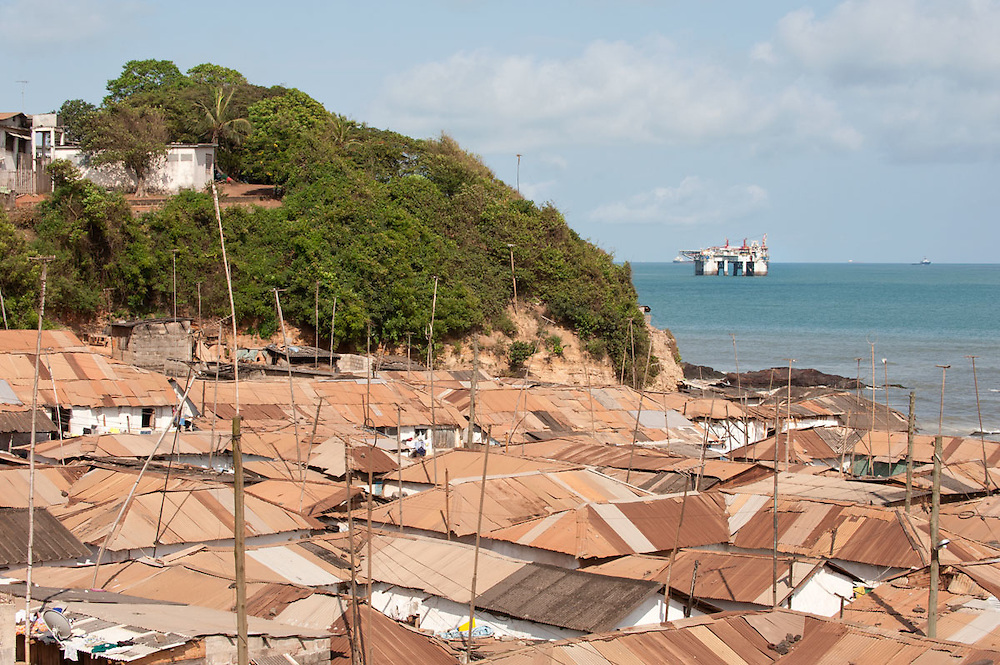 Roofs of New Takoradi with view on oil rig off shore, Ghana 2011