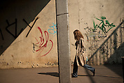 A woman passing through an underpass in the city of Katowice, Silesia, Poland. April 2009.