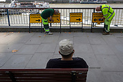 Workmen with apedestrian diversion arrows signs overlooking the river Thames, on 1st September 2017, on the Southbank, in London, England.