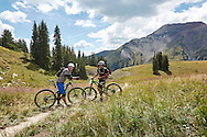 Friends taking in the view while mountain biking Trail 401 trail near Crested Butte, Colorado.