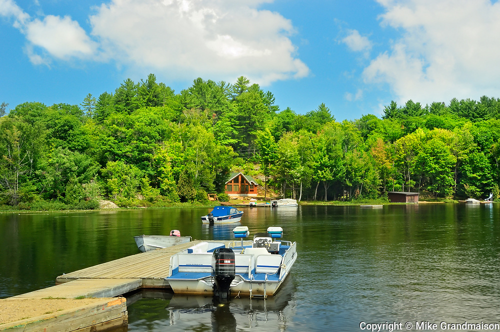 Cottage and boat on Raven Lake, Dorset, Ontario, Canada