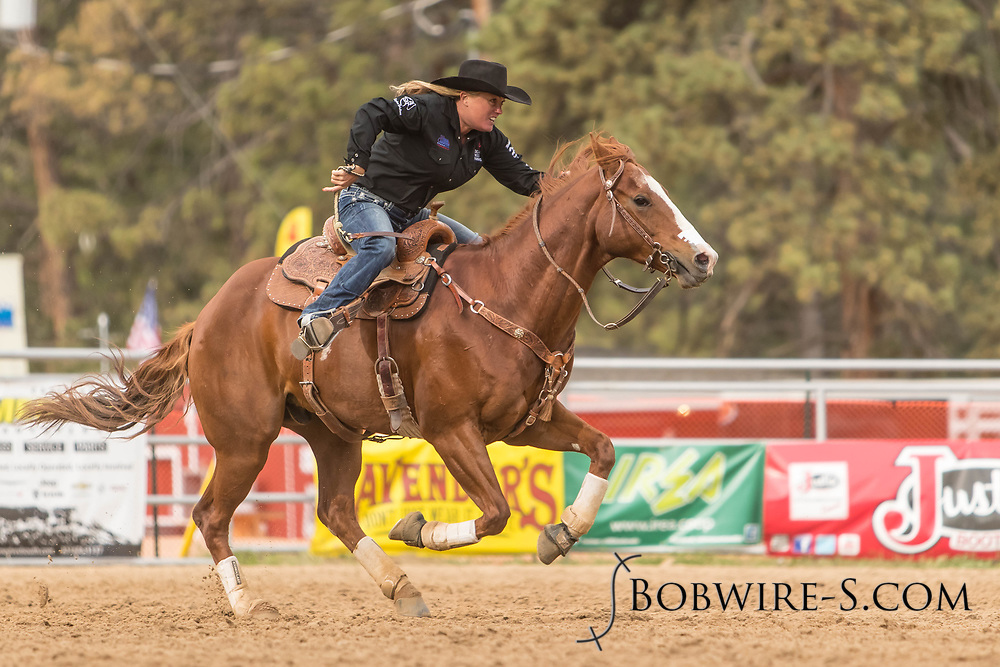 Nathalie Snyder makes her barrel racing run during slack at the Elizabeth Stampede on Sunday, June 3, 2018.
