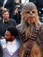 Donald Glover, and Chewbacca, at the Solo: A Star Wars Story gala screening at the 71st Cannes Film Festival, Tuesday 15th May 2018, Cannes, France. Photo credit: Doreen Kennedy