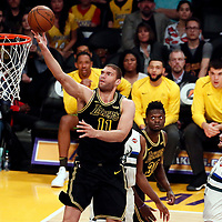 30 March 2018: Los Angeles Lakers center Brook Lopez (11) goes for the layup during the Milwaukee Bucks 124-122 victory over the LA Lakers, at the Staples Center, Los Angeles, California, USA.