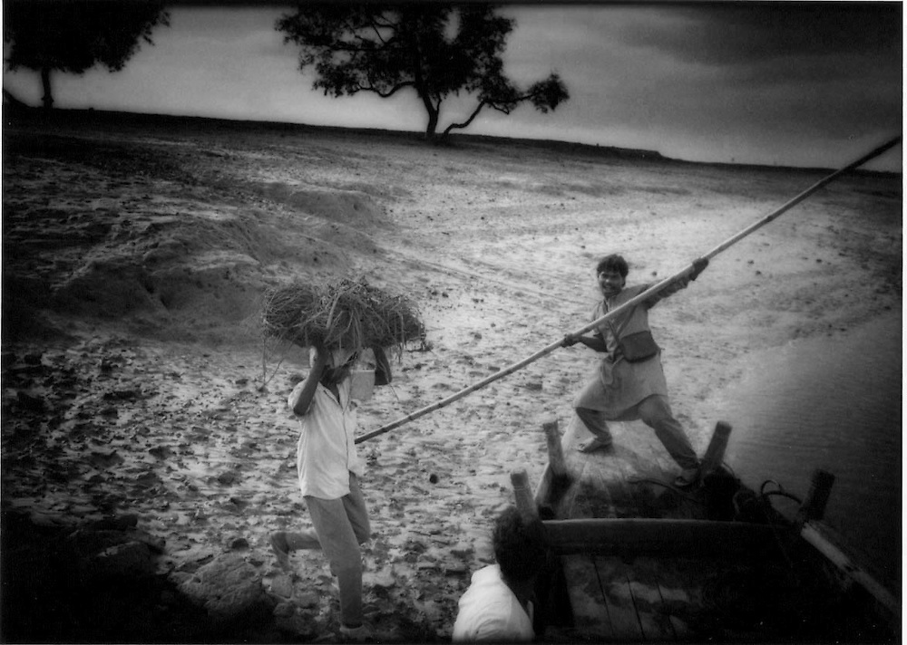 Poling a River Ferry, Sundarbans, West Bengal.