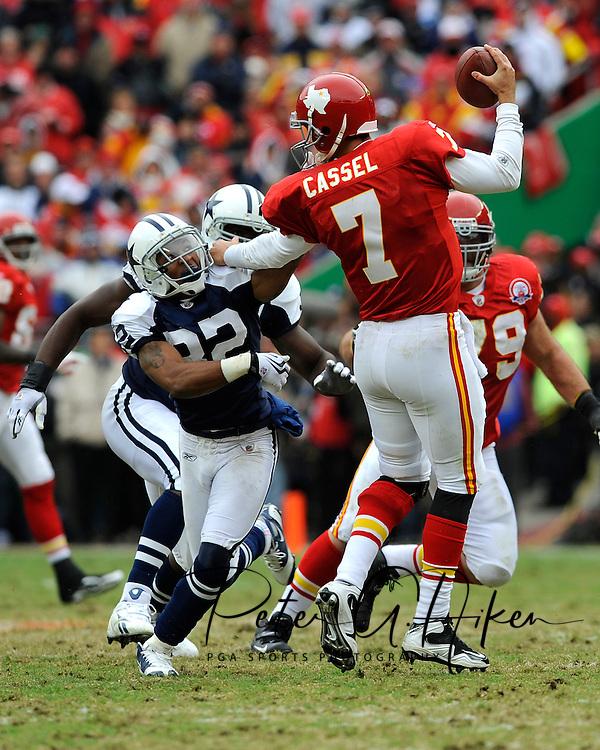 October 11, 2009:   Quarterback Matt Cassel #7 of the Kansas City Chiefs stiff-arms defensive back Orlando Scandrick #32 of the Dallas Cowboys in the second half at Arrowhead Stadium in Kansas City, Missouri.  The Cowboys defeated the Chiefs in overtime 26-20...