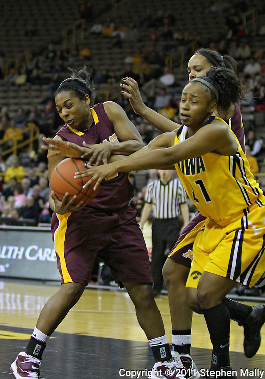 February 10 2011: Minnesota Golden Gophers guard China Antoine (2) and Iowa Hawkeyes guard Kachine Alexander (21) battle for a rebound during the first half of an NCAA women's college basketball game at Carver-Hawkeye Arena in Iowa City, Iowa on February 10, 2011. Iowa defeated Minnesota 64-62.