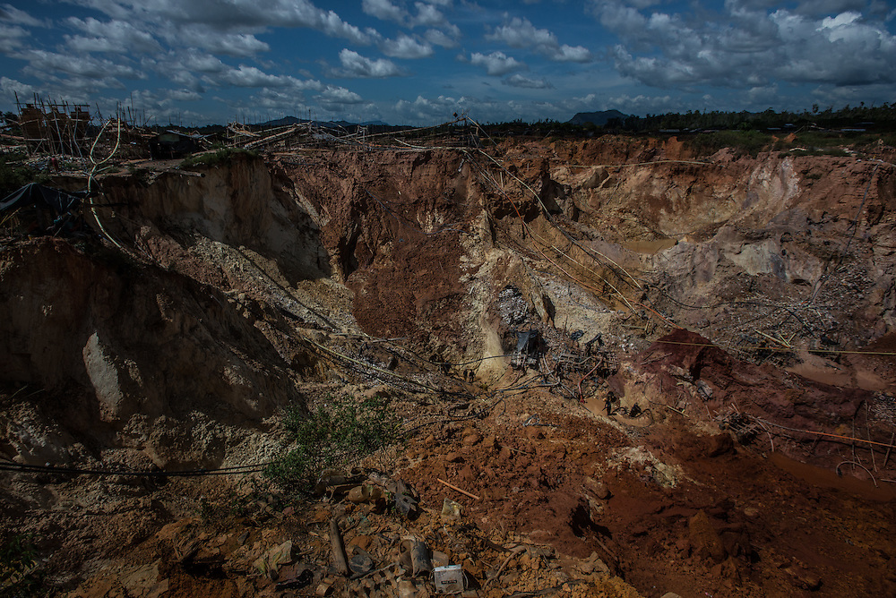 """LAS CLARITAS, VENEZUELA - JULY 20, 2016:  Thousands of Venezuelans are flocking to illegal gold mines, like this one, called """"Cuatro Muertos"""" (""""Four Dead"""" because four miners have died here since the mine was dug) in hopes of surviving the current economic crisis by earning in gold instead of the national currency, whose value steadily falls due to the world's highest inflation.  From this remote part of the jungle the migrant miners have become the vectors of a new epidemic of malaria, because the hot, swampy conditions of the mines make for an ideal breeding ground for mosquitos. Miners spread the disease as they return home with earnings or pay visits to family members. Dozens of miners that work in this mine said that they have contracted malaria multiple times, some even dozens of times. The economic crisis has also left the government without the financial resources to control the disease - they are unable to fumigate homes, provide medicines to everyone that is sick, or even to test all patients with symptoms of malaria in many places. PHOTO: Meridith Kohut"""