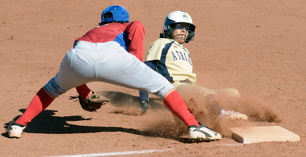 gbs040417f/SPORTS -- Atrisco Heritage's Jennifer Hernandez, left, slides safely in to third base as West Mesa 's Eva Perez is late on the tag in the second inning of the game at West Mesa on Tuesday, April 4, 2017. (Greg Sorber/Albuquerque Journal)