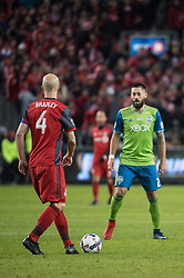 December 9, 2017 - Toronto, Ontario, Canada - Toronto FC midfielder MICHAEL BRADLEY (4) dribbles the ball while defended by Seattle Sounders midfielder CLINT DEMPSEY (2) during the MLS Cup championship match at BMO Field in Toronto, Canada.  Toronto FC defeats Seattle Sounders 2 to 0. (Credit Image: © Mark Smith via ZUMA Wire)