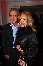 MR & MRS ROBERT LACEY at a party hosted by jeweller Theo Fennell and Dominique Heriard Dubreuil of Remy Martin fine Champagne Cognac entitles 'Hot Ice' held at 35 Belgrave Square, London, W1 on 26th October 2004.<br /><br />NON EXCLUSIVE - WORLD RIGHTS