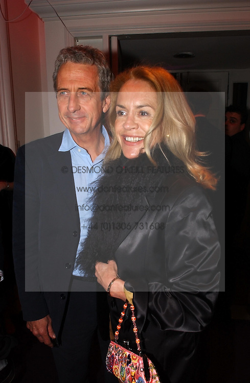 MR &amp; MRS ROBERT LACEY at a party hosted by jeweller Theo Fennell and Dominique Heriard Dubreuil of Remy Martin fine Champagne Cognac entitles 'Hot Ice' held at 35 Belgrave Square, London, W1 on 26th October 2004.<br />