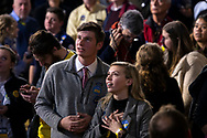 A supporter watches early results on the big screen during a Primary Night Rally with Pete Buttigieg, former mayor of South Bend and 2020 presidential candidate, in Nashua, New Hampshire, U.S., on Tuesday, Feb. 11, 2020. Photographer: Kate Flock/Bloomberg
