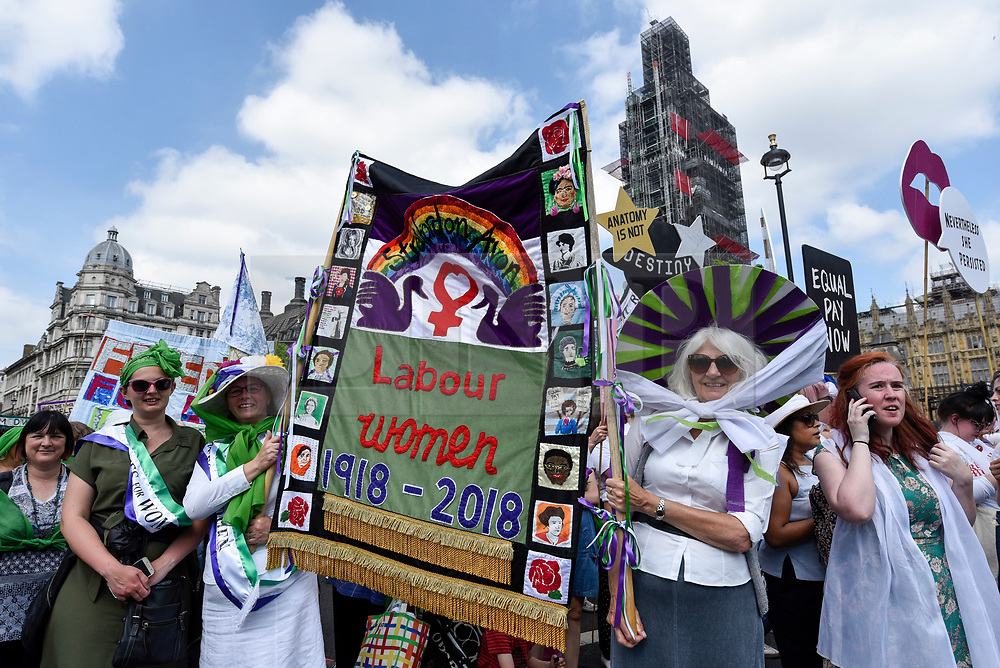 """© Licensed to London News Pictures. 10/06/2018. LONDON, UK.  Over 40,000 women and girls take part in """"Processions"""", a mass participation artwork to celebrate one hundred years of votes for women.  Walking together from Park Lane to Westminster participants wear either green, white or purple scarves representing the colours of the Suffragette movement.  Similar walks took place in Belfast, Cardiff and Edinburgh.  Photo credit: Stephen Chung/LNP"""