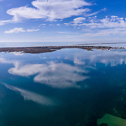 Aerial clouds seascape, in Ria Formosa wetlands natural park, over Cavacos beach. Algarve. Portugal.