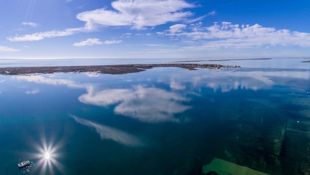 Aerial clouds seascape, in Ria Formosa wetlands natural park, over Cavacos beach. Algarve. Portugal.