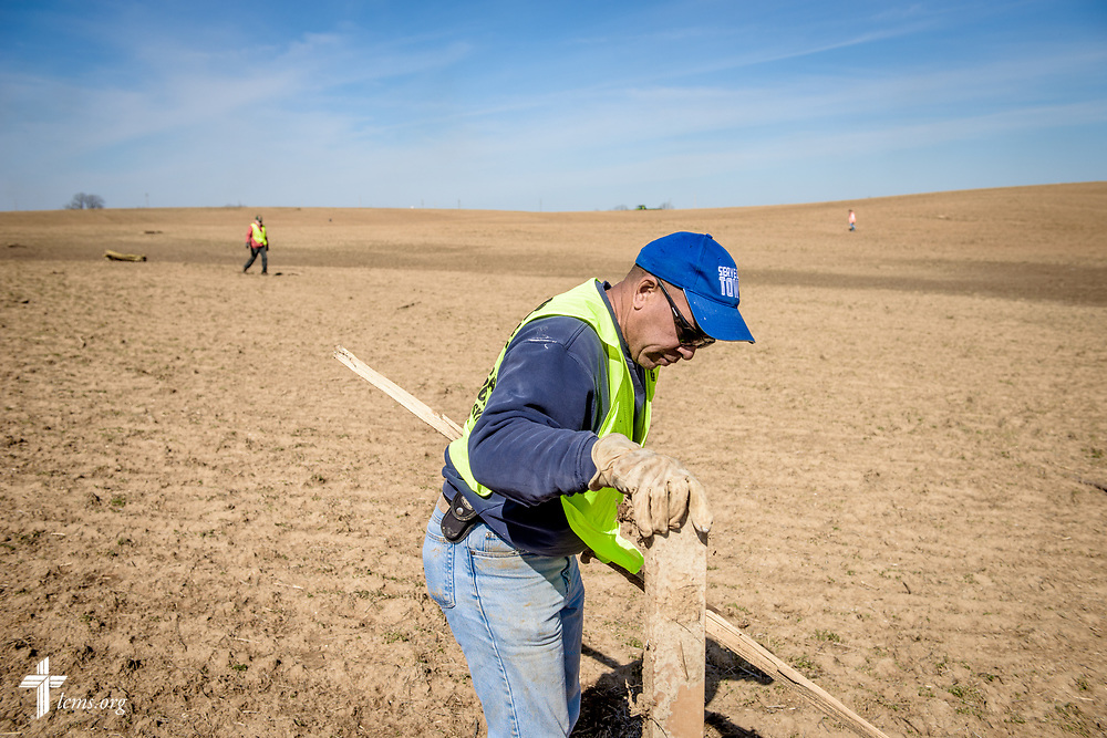 Volunteer Barry Logan of New Beginnings Lutheran Church, Pacific, Mo., helps remove field debris caused from a tornado, on Saturday, March 4, 2017, in Perryville, Mo. LCMS Communications/Erik M. Lunsford