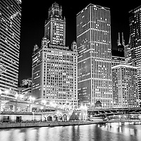 Chicago downtown at night black and white photo. Includes buildings along the Chicago River with 35 East Wacker Drive Building, Unitrin Building, Renaissance Chicago Hotel, Leo Burnett Building and Irv Kupcinet Bridge (Wabash Avenue Bridge).
