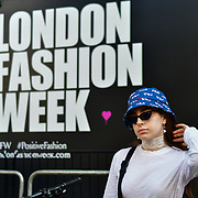 Eman Rostrum @lemondinary attend London Fashion Week SS19 street photography at the Strand, London, UK. 17 September 2018.