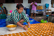Thai women making Mango Leather (Mamuang Guan หนังมะม่วง) in rural Thailand