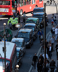 © Licensed to London News Pictures. 21/04/2015. <br /> LONDON, UK. London's taxi drivers go on strike on Oxford Street against Transport for London. Members of the United Cabbies Group claim that TFL are 'failing to regulate the taxi industry', while app services are unregulated and no checks are in place to check if drivers are legitimate. Photo credit : Hannah McKay/LNP