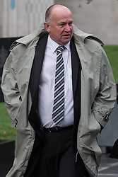 © Licensed to London News Pictures . 08/12/2014 . Manchester , UK . Former Humberside Police Detective Chief Superintendent COLIN ANDREWS (57) outside Manchester Crown Court . Andrews is charged with the rape of a woman in December 2003 and with stalking , common assault and harassment . Photo credit : Joel Goodman/LNP/LNP