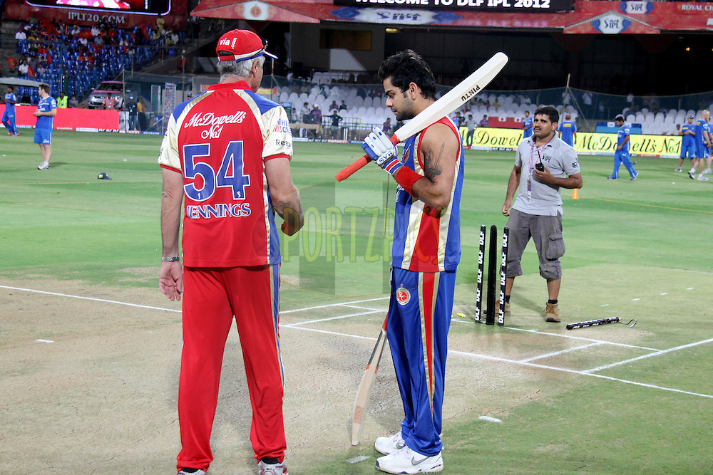 Virat Kohali takes a look at pitch during warmup session before match 50 of the the Indian Premier League ( IPL) 2012  between The Royal Challengers Bangalore and the Deccan Chargers held at the M. Chinnaswamy Stadium, Bengaluru on the 6th May 2012..Photo by Prashant Bhoot/IPL/SPORTZPICS
