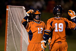 Virginia Cavaliers M Drew Thompson (12) and Virginia Cavaliers A Garrett Billings (19) celebrate a goal against UNC.  The Virginia Cavaliers Men's Lacrosse Team defeated the North Carolina Tar Heels 10-9 in overtime at Klockner Stadium in Charlottesville, VA on April 7, 2007.