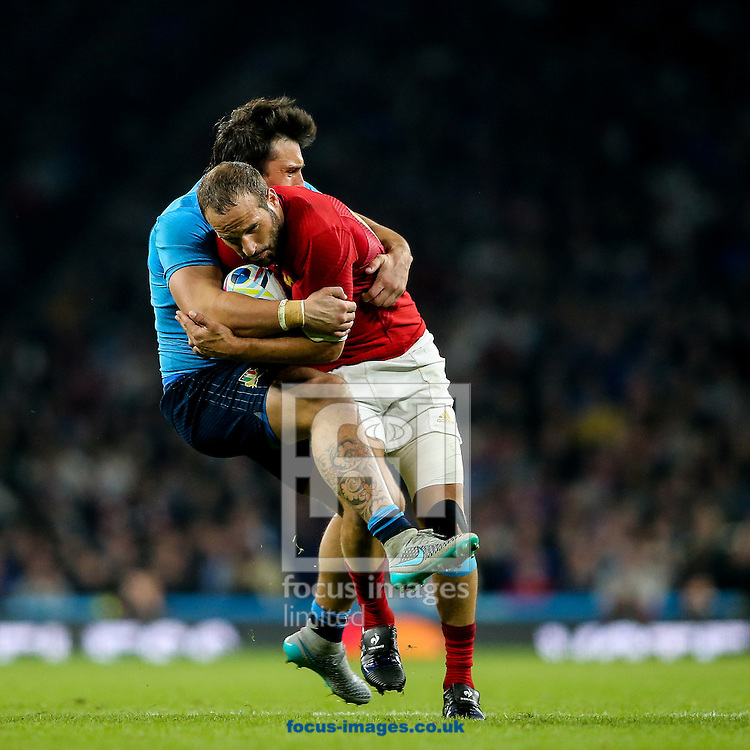 Enrico Bacchin of Italy (left)  tackles Frederic Michalak of France (right) during the 2015 Rugby World Cup match at Twickenham Stadium, Twickenham<br /> Picture by Andy Kearns/Focus Images Ltd 0781 864 4264<br /> 19/09/2015