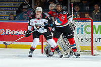 KELOWNA, BC - DECEMBER 18:  Jadon Joseph #18 of the Kelowna Rockets checks Connor Horning #22 ahead of the net of David Tendeck #30 of the Vancouver Giants during second period at Prospera Place on December 18, 2019 in Kelowna, Canada. (Photo by Marissa Baecker/Shoot the Breeze)