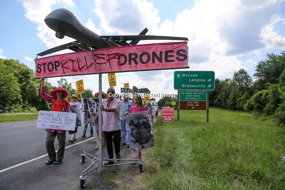 Protesters against drone strikes attempt to deliver a letter to U.S. Central Intelligence Agency (CIA) Director John Brennan as they gather outside CIA headquarters in Langley, Virginia.