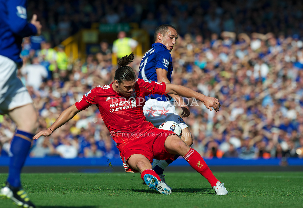 LIVERPOOL, ENGLAND - Saturday, October 1, 2011: Liverpool's Andy Carroll in action against Everton's Leon Osman during the Premiership match at Goodison Park. (Pic by David Rawcliffe/Propaganda)