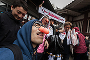 Japanese men wearing joke glasses with penis nose pieces during the Kanamara Matsuri, (Festival of the Steel Phallus). Kawasaki Daishi, Kanagawa, Japan. Sunday April 3rd 2016. The famous Kawasaki Penis Festival started in 1977 as a small festival to celebrate an old legend about the defeat of a penis eating demon. Today the festival is a huge draw for Japanese and foreign tourists and raises money for HIV and AIDS research.