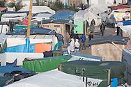 Calais, Pas-de-Calais, France - 23.10.2016    <br />  <br /> Last day of the of the so called &rdquo;Jungle&quot; refugee camp on the outskirts of the French city of Calais before the scheduled eviction. Many thousands of migrants and refugees are waiting in some cases for years in the port city in the hope of being able to cross the English Channel to Britain. French authorities announced that they will shortly evict the camp where currently up to up to 10,000 people live.<br /> <br /> Letzter Tag des sogenannten &rdquo;Jungle&rdquo; Fluechtlingscamp am Rande der franzoesischen Stadt Calais vor der angesetzten Raeumung. Viele tausend Migranten und Fluechtlinge harren teilweise seit Jahren in der Hafenstadt aus in der Hoffnung den Aermelkanal nach Gro&szlig;britannien ueberqueren zu koennen. Die franzoesischen Behoerden kuendigten an, dass sie das Camp, indem derzeit bis zu bis zu 10.000 Menschen leben K&uuml;rze raeumen werden. <br /> <br /> Photo: Bjoern Kietzmann