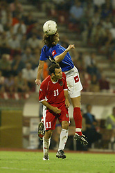 BELGRADE, SERBIA & MONTENEGRO - Wednesday, August 20, 2003: Wales' Ryan Giggs and Serbia & Montenegro's Goran Gavrancic during the UEFA European Championship qualifying match at the Red Star Stadium. (Pic by David Rawcliffe/Propaganda)