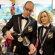 Two sommeliers are seen at one of the stands of the Biennale del Gusto on October 28, 2013 in Venice, Italy. The Biennale del Gusto is an exhibition held over four days, dedicated to traditional food and drinks from all regions of Italy.