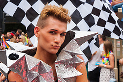 Brighton, August 2nd 2014. A young man poses for the camera during Brighton Pride.